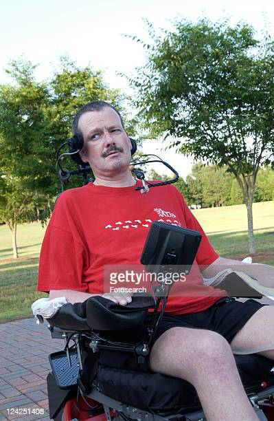 image of a man with significant disabilities, including total body paralysis, experiencing life in the community with the assistance of technology that promotes independence. - quadriplegic fotografías e imágenes de stock