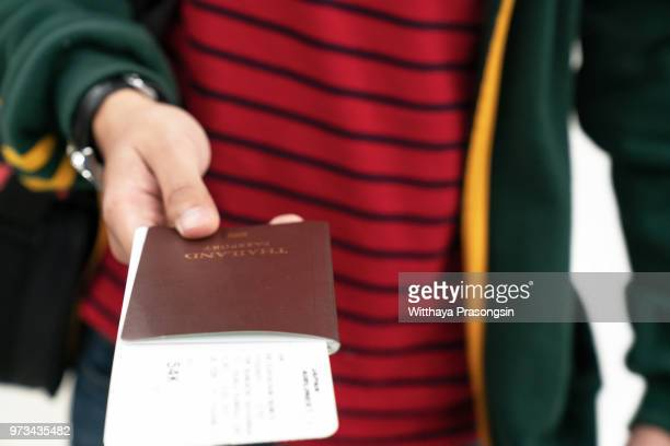image of a persons hand holding a passport - global citizen stock pictures, royalty-free photos & images