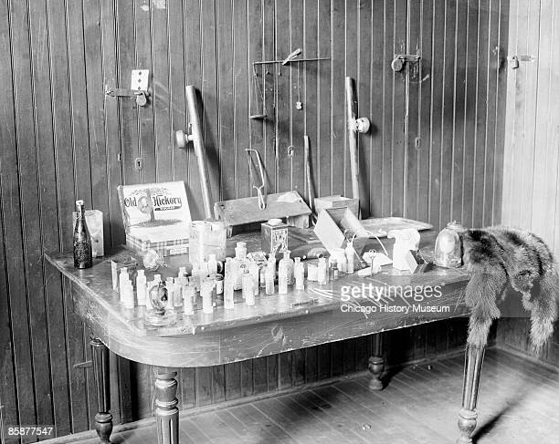 Image of a table containing cocaine opium and morphine taken from dope fiends in Chicago Illinois 1908 From the Chicago Daily News collection