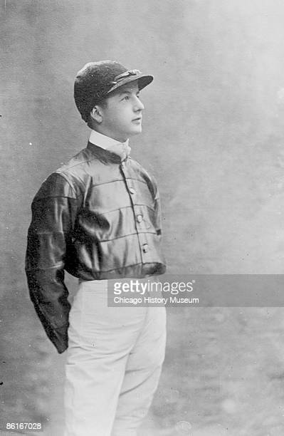 Image of a threequarter length portrait photograph of John Reiff a jockey standing wearing riding silks This image was taken in Chicago Illinois 1901