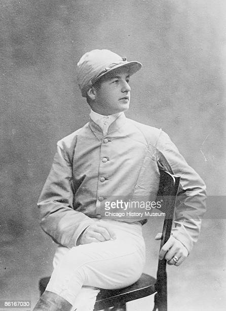 Image of a three-quarter length portrait photograph of John Reiff, a jockey, sitting, wearing riding silks. This image was taken in Chicago,...