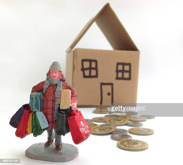 Image of a woman with shopping bags, coins and dollshouse