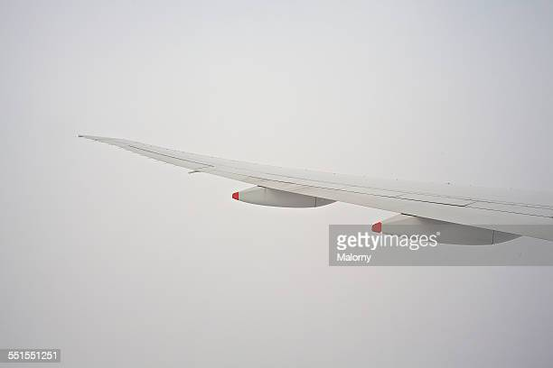 Image Of Airplane In Front Of A Foggy Sky