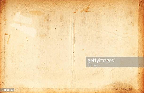 Image of an old, grungy piece of paper with creases and stains.