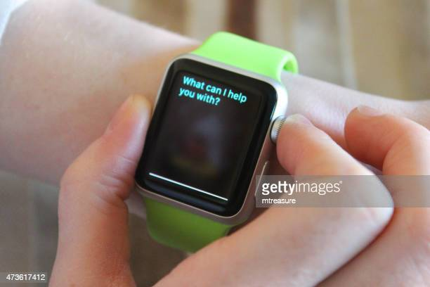 image of apple watch being used, siri app clock face - siri mobile app stock pictures, royalty-free photos & images