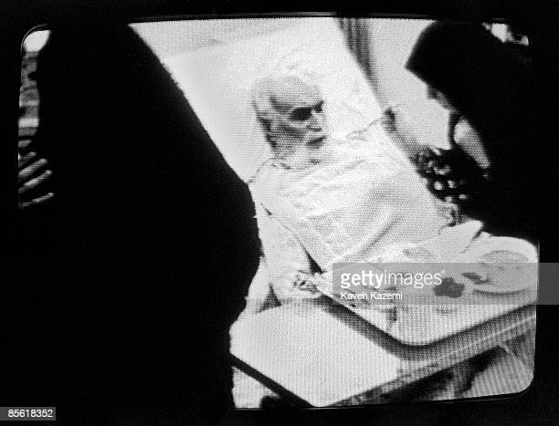 A TV image of Ayatollah Khomeini being fed in bed by a female member of the family hours before his death in his north Tehran residence in Jamaran...