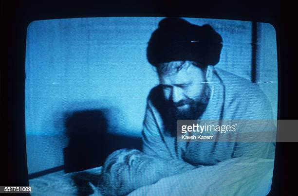 A TV image of Ayatollah Khomeini mourned by his son Ahmad after his death on 3rd June 1989