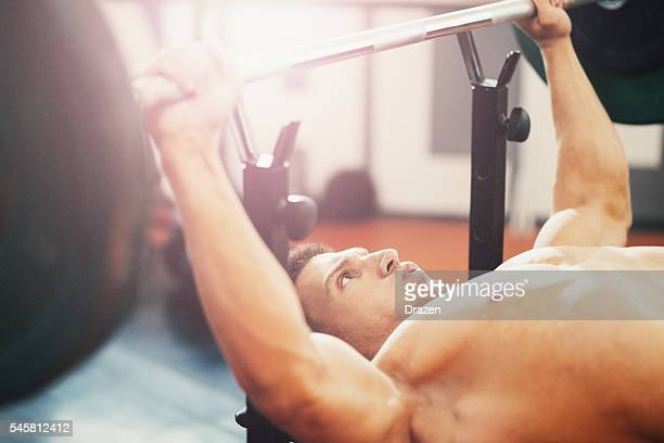 Image of body builder lifting weights on bench press