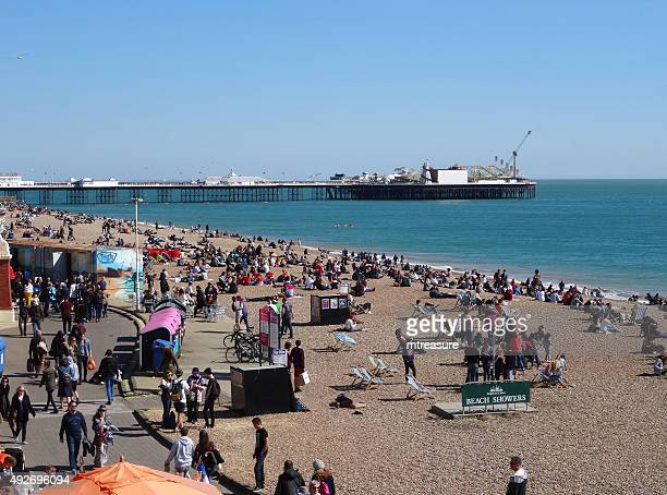 image of brighton pier and beach with summer holidaymaker crowds - brighton beach england stock pictures, royalty-free photos & images