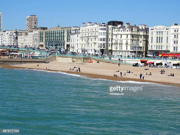 image of brighton seafront, beach, shops, tourists and holidaymakers - brighton beach england stock pictures, royalty-free photos & images