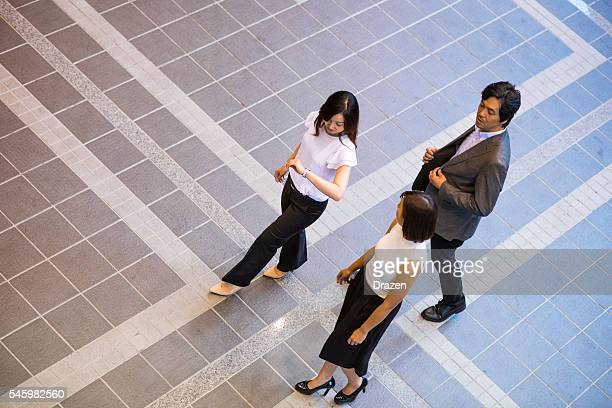 Image of business people at work from above