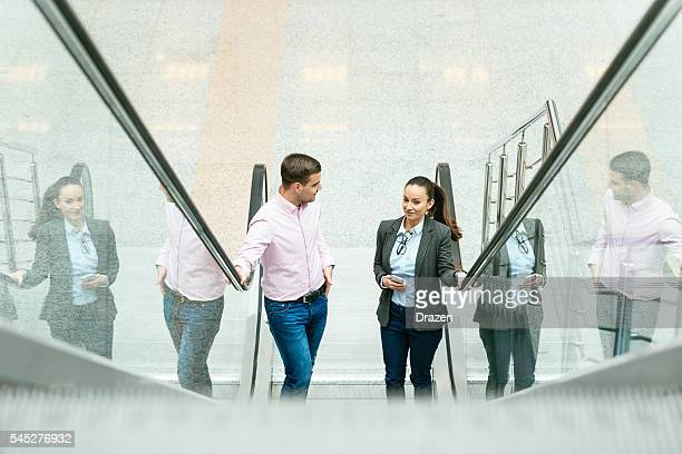 Image of business people moving up in career