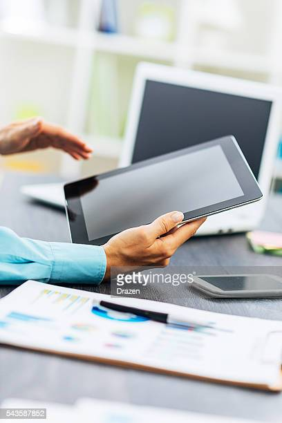 Image of business person in office reading financial news