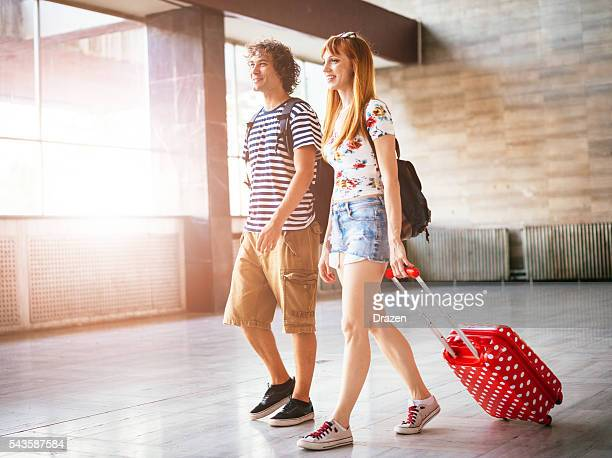 Image of cheerful couple traveling together on summer trip