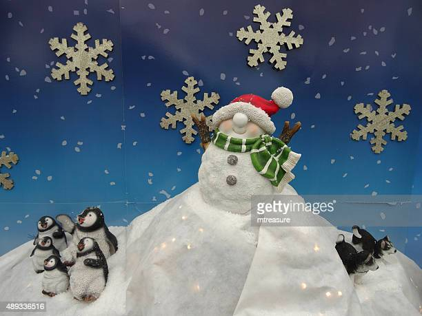 Image of Christmas display of snowman toy, penguins and husky-dogs