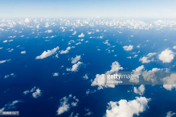 Image of clouds and ocean from a airplane