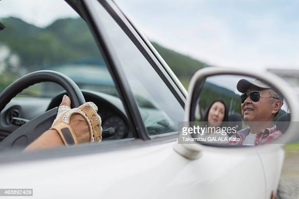 Image of couple in wing mirror