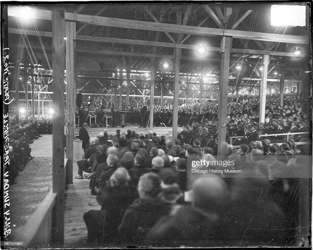 Astonishing Image Of Crowd Of People Sitting On Benches In Rows Inside Alphanode Cool Chair Designs And Ideas Alphanodeonline