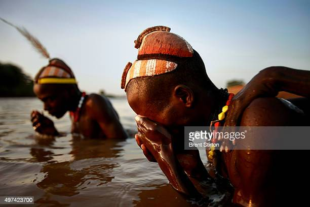 Image of Dassanech herdsmen bathing after watering their cattle on the banks of the all important Omo River the chief life source in the Lower Omo...
