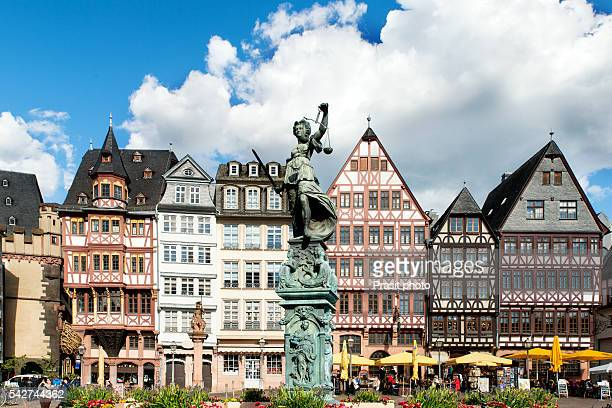 image of frankfurt, germany - old town square romerberg with justitia statue in frankfurt, germany. frankfurt is the largest city in the germany state of hesse. - frankfurt main stock pictures, royalty-free photos & images