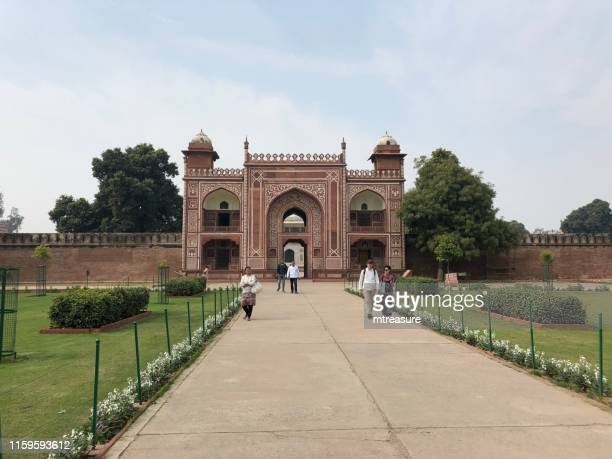 image of gateway to itmad / itimad ud daulah tomb and topiary tree gardens, mughal mausoleum (baby taj mahal historic site photo) in agra city, uttar pradesh, india - sandstone stock pictures, royalty-free photos & images
