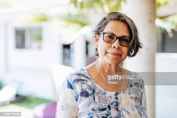 image of healthy senior latinx woman with gray hair and eyewear. - latin american and hispanic ethnicity stock pictures, royalty-free photos & images