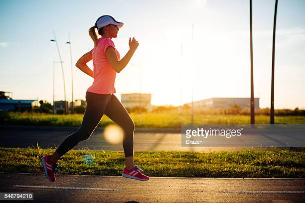 image of healthy young recreational jogging woman - drazen stock pictures, royalty-free photos & images