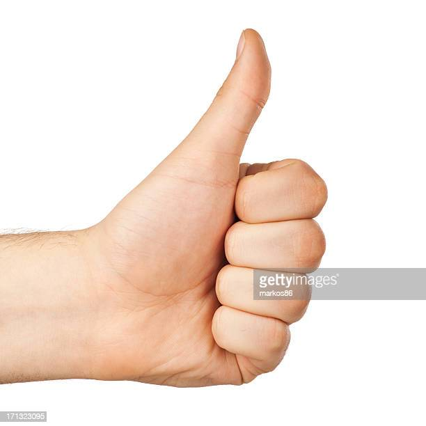 Image of human hand with thumb up.Studio shot.OK sign gesture.