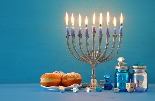 image of jewish holiday Hanukkah background with menorah (traditional candelabra) and candles. 1058438718