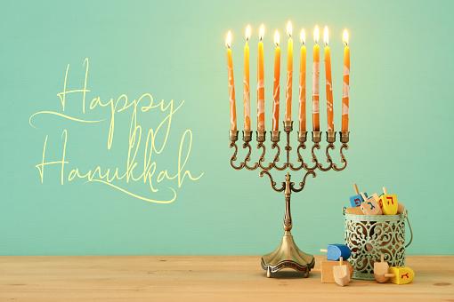 image of jewish holiday Hanukkah background with menorah (traditional candelabra). 1065483054
