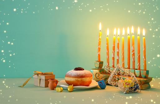 image of jewish holiday Hanukkah background with menorah (traditional candelabra). 1067398402