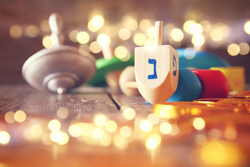 Image of jewish holiday Hanukkah with wooden dreidels 617747906
