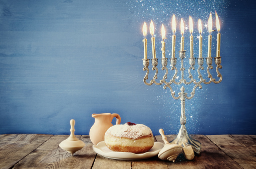 Image of jewish holiday Hanukkah with wooden dreidels 843407928