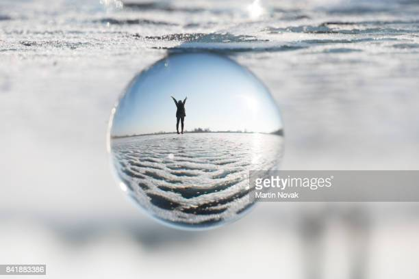 Image of joyous woman captured in sphere ball
