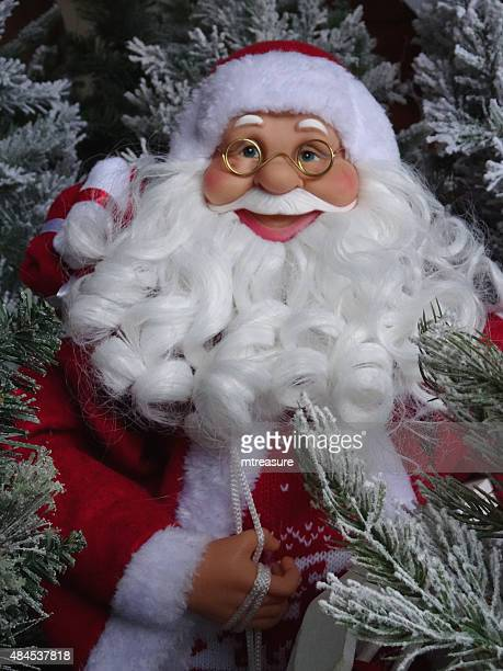 image of large santa claus / father christmas toy figure, smiling - cartoon santa claus stock photos and pictures