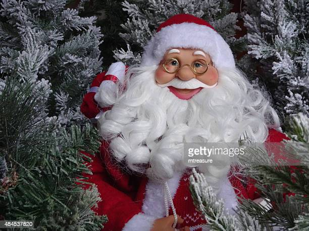 image of large toy santa claus with bushy white beard - cartoon santa claus stock photos and pictures