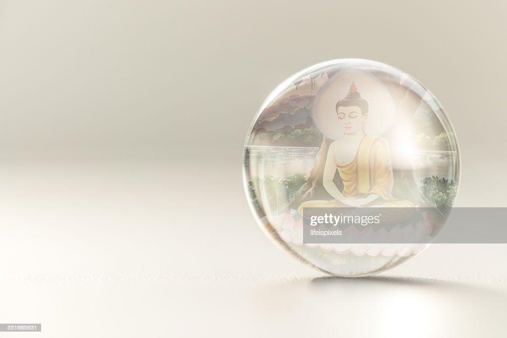 Image of Lord Buddha inside crystall ball : Stock Photo