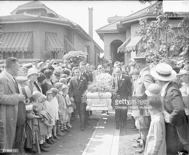 Image of men carrying the casket of reputed labor racketeer 'Big Tim' Timothy Murphy down a walkway in front of a house in Chicago Illinois June 1928...