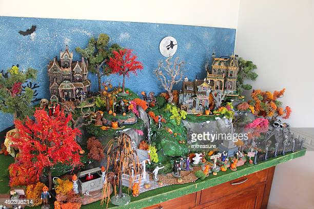 Image of miniature Halloween village with Lemax Spooky Town buildings