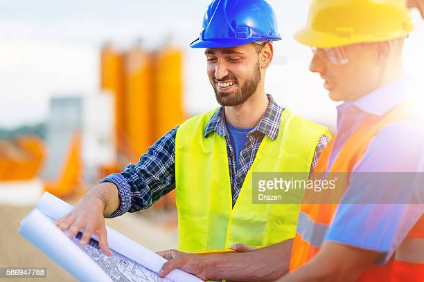 image of mining engineers with project draft - civil engineering stock pictures, royalty-free photos & images