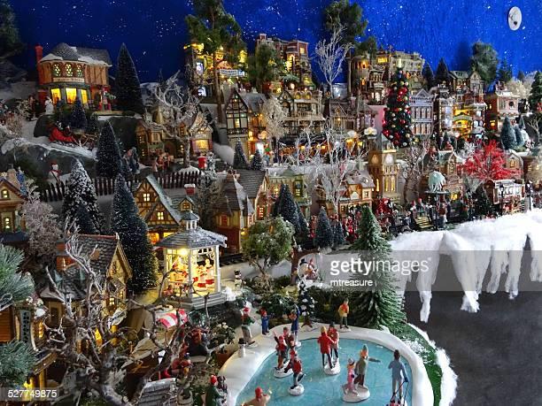 image of model christmas village with miniature houses, people, winter-scene - dorp stockfoto's en -beelden
