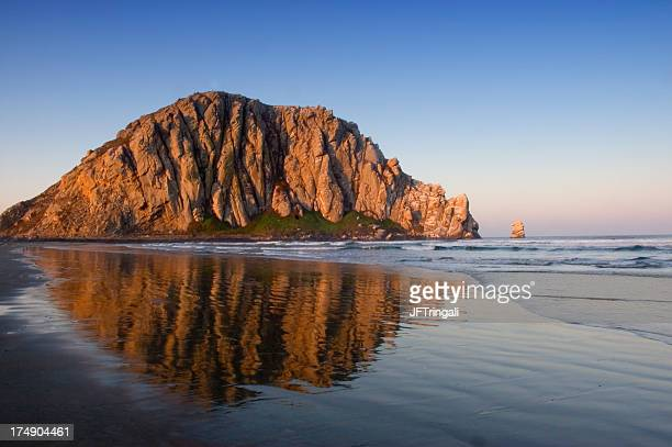 Image of Morro Rock and its reflection in water
