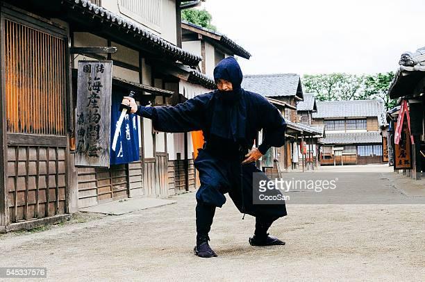 image of ninja in traditional japanese village - ninja fotografías e imágenes de stock
