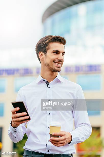 'image of one young businessman using phone - drazen stock pictures, royalty-free photos & images
