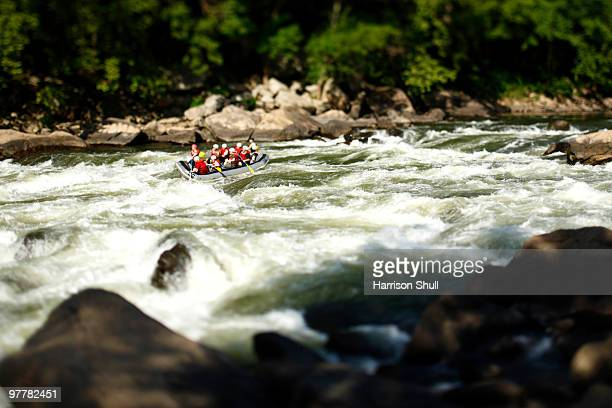 image of rafters in the fayette station rapids on the new river at fayetteville, west virginia. - whitewater rafting stock pictures, royalty-free photos & images