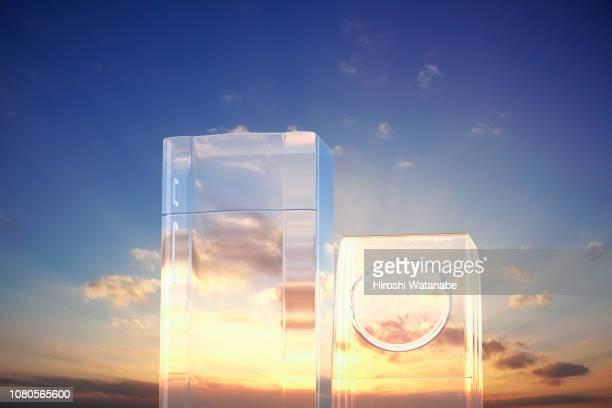 image of renewable energy. transparent refrigerator and washing machine at sunset. - frigo humour photos et images de collection