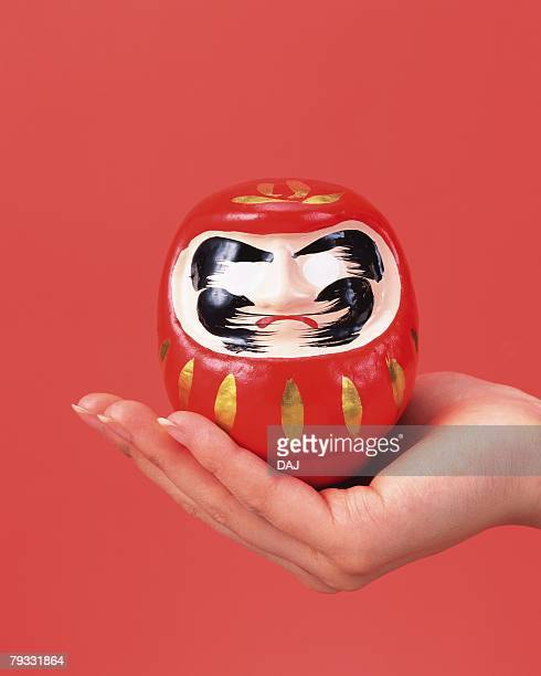 Image of Right Hand Holding a Daruma, Front View