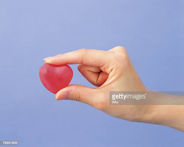Image of Right Hand Picking a Heart, Side View