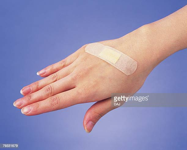 Image of Right Hand With Band Aid, High Angle View