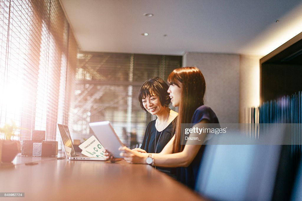 Image of smiling Japanese successful business community at work : ストックフォト